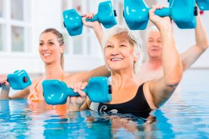 People,Young,And,Senior,In,Water,Gymnastics,Physiotherapy,With,Dumbbells
